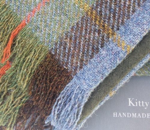 Harris Tweed in Hunting Macleod with green cashmere underside.