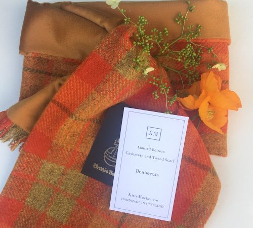 The Benbecula Scarf in orange Harris Tweed lined with Scottish Cashmere